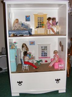 dresser recycled into a Barbie house. I know 3 little girls who would love this.