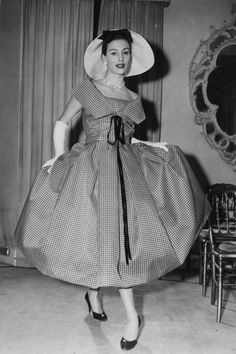 """1957 ~ Pagan Grigg wears 'Casino', a black and white window pane check organza dress and waist length jacket with a matching sou'wester hat, from the mid season collection at Christian Dior London"