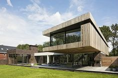 """""""Hilberink Bosch Architects designed a modern home, situated at the edge of a forest in Heesch, The Netherlands"""""""