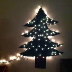 Our Xmas tree is up. It is fake, made out of felt with a string of lights tacked up. :-)