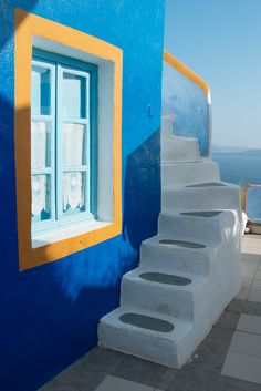 https://flic.kr/p/qGbxqD   Santorini: Oia   Would you like to support my work and order a print for your home or office? Get your personal high quality print here! The owner of this house explained to my why he chose these colors: The dark blue of the wall symbolizes the Aegean sea, the dark yellow stands for the fertile Santorini soil and the light blue of the window frame is the sky above the island. This house is pure poetry. :)