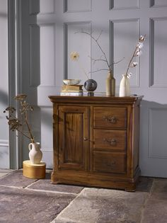 Ideal for people looking to add a bit more storage to their home, the Cranbrook storage cabinet is a strikingly elegant solution. The high quality piece for your dining room, living room, or home office, is made from durable solid hardwood in a dark-stained finish, keeping your belongings safe and looking great for years to come.