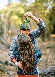 Couple underneath some mistletoe