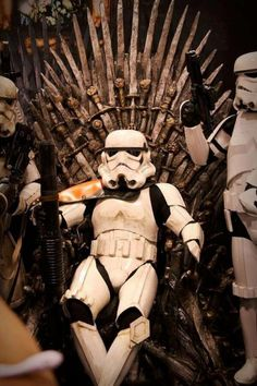 He who sits on the throne wears a heavy helmet.  Star Wars meets Game of Thrones