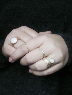 Styling by josephinehlindhard showing Bubble Facet Ring Pink Xlarge Gold, Delight diadem Zirconia Ring Gold, Bubble Ring Pink Medium Gold, Cross Ring Gold and Highlight Ring Gold #jewellery #Jewelry #bangles #amulet #dogtag #medallion #choker #charms #Pendant #Earring #EarringBackPeace #EarJacket #EarSticks #Necklace #Earcuff #Bracelet #Minimal #minimalistic #ContemporaryJewellery #zirkonia #Gemstone #JewelleryStone #JewelleryDesign #CreativeJewellery #OxidizedJewellery #gold #silver…