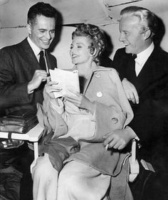 Larry Parks, Rita Hayworth and Roland Culver between scenes of Down to Earth