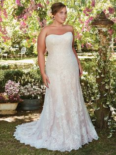 "Check out this lace a-line Rebecca Ingram gown ""MARIAH"" currently in our plus size collection.  Call us today at 941.925.5888 to schedule your appointment with our bridal experts."