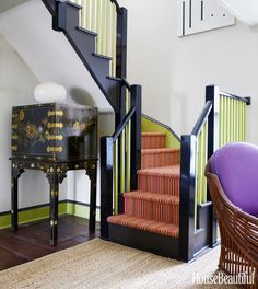 The original staircase got a colorful update with Benjamin Moore's Brookside Moss and Safety Black.