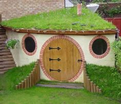 Hobbit Playhouse...uh..I'm going to build this for myself when I'm older and not let my kids in it. hahaha