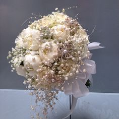 White peonies with brooch and pearls