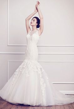 Brides: Kenneth Winston. A unique display of color in this ombre inspired gown. Ivory Cotton lace creates a soft touch and feel from the bodice as it gently falls into a mixture of colors in the full volume skirt. Zipper back.��See More Kenneth Winston Gowns