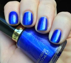 Revlon Sultry Nail Polish- is a medium cobalt blue with pink shimmer (pink!!)
