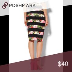 "❤🎉HOST PICK🎉❤ NWT NY&CO Floral Bandage Skirt Beautiful NWT 7th Avenue floral bandage skirt by New York & Company. Just didn't fit exactly how I liked! Fits like an 18/20 in my opinion. I hate having to rehome it! Small slit in the back. Materials are 80% polyester 20% rubber. Form-fitting and flattering! Measurements are approx. 20.75"" across the waistband (laying flat) and 26.5"" long. New York & Company Skirts Pencil"