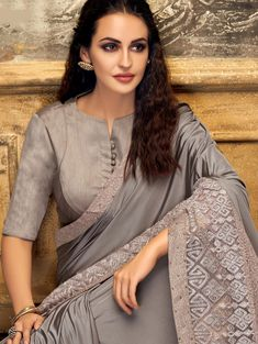 Product Features: Color: Grey Fabric: Lycra, Fancy Net Blouse Fabric: Raw Silk Saree Length: M Blouse Length: M Type of Work: Thread Embroidered Work Product Weight: kg Disclaimer: Color and Texture may have slight variation due to photography Blouse Designs High Neck, Sari Blouse Designs, Saree Blouse Patterns, Fancy Blouse Designs, Bridal Blouse Designs, Kurta Designs, Kurta Neck Design, Sleeves Designs For Dresses, Stylish Blouse Design