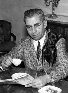 This is a look: Sulka robe, tie and custom made shirt. Lucky Luciano in exile in Italy with his dog, Bambi. Seems like he's living La Dolce Vita, but he was really missing New York and pastrami sandwiches.