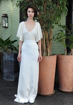 Sarah Seven sheath style wedding dress with crystal beaded ivory bodice, deep v-neckline and flutter sleeves and white skirt Fall 2016 | https://www.theknot.com/content/sarah-seven-wedding-dresses-bridal-fashion-week-fall-2016
