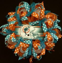 NFL Wreaths Miami Dolphins Wreaths Miami by wreathsbyrobin Wreath Crafts, Diy Wreath, Wreath Ideas, Dolphin Craft, Football Wreath, Baseball Wreaths, Sister Crafts, Felt Squares, Sports Wreaths