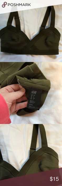 H&M Olive Green Bandage Bikini Top, size 8 H&M Olive Green Bandage Bikini Top worn once. Cute gold detail on straps and clasp on back. Super flattering and unique! Selling because I have too many bathing suits. H&M Swim Bikinis