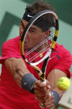 Rafael Nadal of Spain returns in his fourth round match against Juan Monaco of Argentina at the French Open tennis tournament in Roland Garros stadium in Paris, Monday June 4, 2012. Nadal won in three sets 6-2, 6-0, 6-0. (AP Photo/Michel Euler)