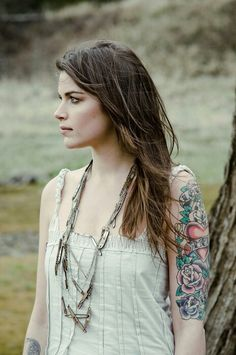 Girl with half sleeve tattoo