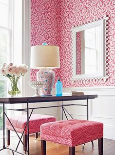 Bright bold pink and white office / bedroom. Geometric wallpaper chair rail up. Wainscoting.