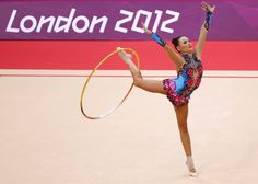 Uzbekistan's Ulyana Trofimova competes using the hoop in her individual all-around gymnastics qualification match at the Wembley Arena during the London 2012 Olympic Games
