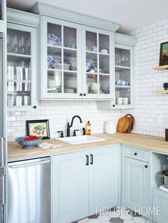 Photo Gallery: Affordable Home Reno Tips | House & Home: subway tile and butcher block countertops, light and airy color scheme