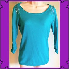 """JUST INNWT Express teal 3/4 sweater top JUST INNWT Express teal 3/4 sweater top. Silver embellishments on shoulders, Ruched sleeves. Very soft & stretchy rayon/nylon/spandex blend. Light sweater like material. Perfect for spring! Measures approx 26"""" long, 15"""" sleeves, & 18"""" across chest. Size small. Bundle to save 10%! Please check out my other Express listings to save even more!NO TRADES, no modelingReasonable offers accepted thru offer button Express Sweaters Crew & Scoop Necks"""