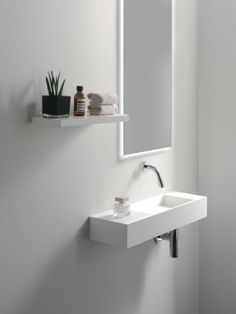 Beautiful Bathrooms, Modern Bathroom, Small Bathroom, Solid Surface, Bathroom Styling, Bathroom Interior Design, Small Downstairs Toilet, Shower Installation, Small Sink