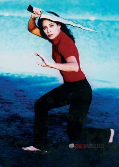 Martial artist Diana Lee Inosanto performing Kali and Arnis with Kris swords