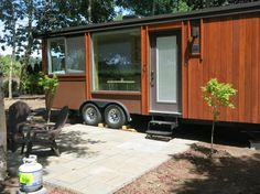 This is the ESCAPE Vista tiny house vacation in Salem, Oregon. It's located in a vineyard with views of Eola Hills and the Willamette River in Oregon's Willamette Valley. Inside the tin…