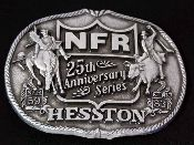 """This is an adult, new, mint, Hesston 1983 25th Anniversary buckle. This buckle has the original order form with it, which is also in un-touched condition. The buckle is 3 1/2"""" long and has no scratches, dents, dings or even tarnish. If you're a rodeo fan, you gotta have this buckle."""