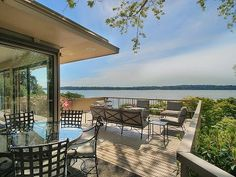 I love this photograph of a deck I found at seattlehomesinsider.com.  Right on the water as well.