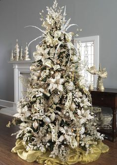 My tree looks a lot like this. I see a few things I can add. I love white, silver & gold. No colors!!! Can't wait to do this with all our kids this year.   { trl}