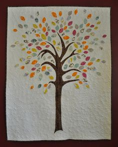 "Thinking this could be a family tree quilt .... every ""branch"" with appropriate names on its leaves?  Not sure how you'd pull that off, but maybe with planning"