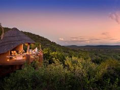 Situated in one of South Africa's largest sanctuaries, Madikwe Safari Lodge offers morning and evening game drives to see Africa's big 5 (lions, leopards, rhinos, elephants, and Cape buffalos) as well as luxurious accommodations with views of game-filled plains.