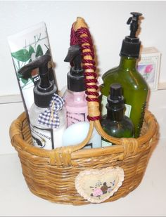 Organize your pump soaps & hand lotions, using a decorative basket.  I bought this basket at Goodwill recently, for $1.99.  It has a pretty resin heart on the front.  I took a pretty wine colored corded rope and wound it around the handle.  This idea would work for a variety of tall-ish items, such as hairspray, curling irons, or whatever you may have.  Get several baskets and add any and all items you desire.  Be creative & have fun! ~ Lady Sweetpea ~