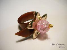 caoutchouc ring (golden flower, bead)