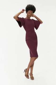 """A dress you won't forget in a hurry. It features a high neckline, flared sleeves, v-back, side split and comes in a midi length.Our Style Editor Mark Heyes says """"This incredibly versatile dress is like the perfect canvas, albeit a beautifully cut and coloured one. It allows you to style it up however you like, and works brilliantly with either a contrast or tonal shade."""" Event Dresses, Nice Dresses, Crepe Dress, Peplum Dress, Side Split, Cut And Color, High Neck Dress, Sleeves, Dress Ideas"""