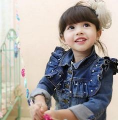 Looking for a denim stylish jacket for your daughter? Look no further. This denim is pretty for your daughter. It is adorned with pearls and ruffles. This is super cute outfit for winter season. This