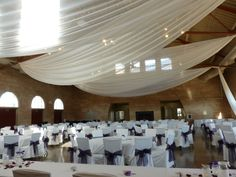 Ivory Ceiling Drape & Ivory Chair Covers with Raisin Organza Sashes (low bow) at Harriet Island by Deckci Decor
