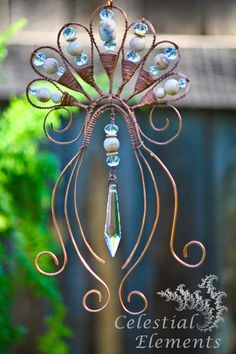 "Lotus Elegance; A elegant handmade suncatcher, with scrolled copper wire. It has a beautiful drop crystal in center. On the top is a symbolic Lotus Flower. size 6"" x 11"" You can find my symbolic interpretation of this piece on newmoonelements.blogspot.com"