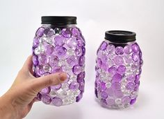 These glittering gem mason jars are a snap to make and so pretty! Diy solar light lids mean they come on every night. Solar Light Crafts, Diy Solar, Mason Jar Lids, Mason Jar Crafts, Halloween Mason Jars, Mirror With Hooks, Mason Jar Lighting, Jar Lights, Boho Diy
