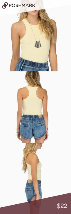 High Neck Crop Tank Cute yellow high neck crop top! Only worn one time, in excellent condition! Tobi Tops Tank Tops