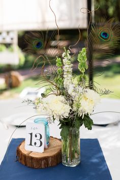 Reception Dinner Table Decor Peacock Feather Centerpiece Flowers | White-Ranch-Wedding-Photographer-Chico-California-TréCreative
