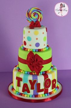 Love the doubling of fondant colors on the bottom tier's name. Taylor By CakesbyDusty on CakeCentral.com