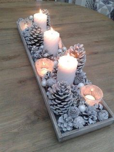Winter holiday / table / home design / decor decorating display / candles / pine cones