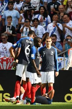 France's forward Antoine Griezmann and France's midfielder N'Golo Kante stand past France's forward Kylian Mbappe lying on the pitch after being fouled during the Russia 2018 World Cup round of Get premium, high resolution news photos at Getty Images World Cup 2018, Fifa World Cup, Raphael Varane, N Golo Kante, Antoine Griezmann, Pitch, Russia, Blues, Soccer