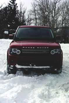 Burgundy red range rover car