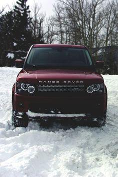 Burgundy red range rover car